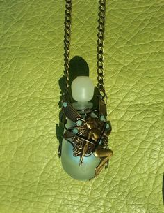 Sold this up-clycled perfume bottle necklace I made to my favorite tattoo artist.