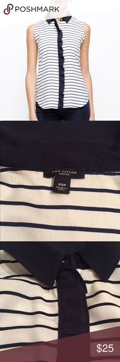 """Ann Taylor Striped Ruffled Blouse Sleeveless flowy top with small ruffles along placket to hide buttons. Slightly curved hem. Stripes could look black/white but actually navy and white. The size """"sounds"""" really really small but I normally wear small for petite tops and this fits but a bit tighter than I would want.  Worn only 1-2 times and in excellent condition. Ann Taylor Tops Blouses"""