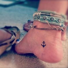 Read Complete Black Little Anchor Tattoo On Girl Heel