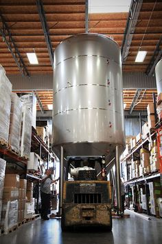 Wheeling a new fermenter tank in at Stone Brewing Co. You'd need to drink a six pack every day for 65 years to empty one of these bad boys.
