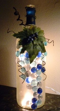 Wine+Bottle+With+Lights+Inside | Decorative Wine Bottle Light embellished with Blue Glass Gems, Leaves ...