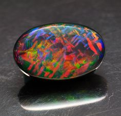 Stones From The Past - Black Opal - Carat: 10.40cts - Size: 19.2 x 12.2 x 7.3 - Oval - EASSS