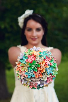 bouquet idea with the origami flowers: Real Flowers can be very expensive, and this is very you Sarah. Not sure how much the paper would be, but, I this it is beautiful