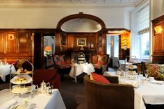The English Tea Room in Brown's Hotel, London - one of the most fashionable afternoon tea venues (Traditional Afternoon Tea is currently priced at $69.50 in American currency) - also, the place where novelist, Agatha Christie penned 'At Bertram's Hotel.'