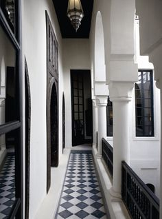My Paradissi: A whimsical riad in Marrakech - This simple use of white stucco with darker wood and metal elements is exactly the type of interplay between industrial and Moroccan that we have been looking for.