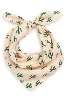 Spotted cacti playfully pattern this chic silk square scarf.