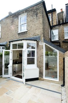 Hire interior designers and builders London for loft conversions and house extensions, such as side return kitchen extensions for Victorian terraced houses. Get an instant online quote and see how you can benefit from a side return extension. House, Glass Roof, Victorian Homes, House Exterior, Bay Window, Roof Light, Kitchen Door Designs, Victorian Terrace, Terrace House
