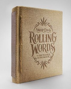 Snoop Dogg's Rolling Words book, made of rolling papers and a striking pad on the spine.