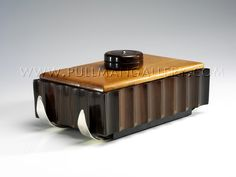 Art Deco 'Ski' cigar box by Emile Jacques Ruhlmann, c.1925, body in Macassar ebony with sycamore lid, the whole resting on silvered skid, French. (Pinned by Retroworx)