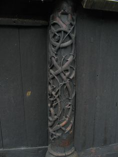 Exterior Detail - Urnes Stave Church is a 12th-century stave church at Ornes, along the Lustrafjorden in the municipality of Luster in Sogn og Fjordane county, Norway. It sits on the eastern side of the fjord, directly across the fjord from the village of Solvorn and about 5 kilometres (3.1 mi) east of the village of Hafslo.