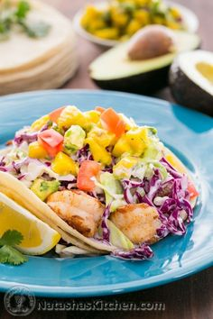 Shrimp Tacos with Coconut Coleslaw. Shrimp Tacos with coconut coleslaw and mango avocado salsa. It's a delicious mouthful for sure! Step-by-step photos! Fish Dishes, Seafood Dishes, Seafood Recipes, Mexican Food Recipes, Cooking Recipes, Healthy Recipes, Main Dishes, Salmon Recipes, Healthy Eats