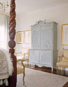 """An antique buffet de corps that houses Price's plasma TV was chosen for the ethereal color of its painted finish — """"an undercoat of gray with a beautiful soft cloud blue on top,"""" she says.   - HouseBeautiful.com"""