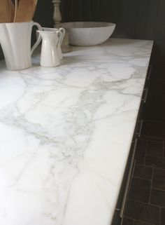 Marble Countertops.  The best surface for rolling out dough.  Therefore.... MUST HAVE(doesn't have to be an entire counter... just a part by the stove or something)
