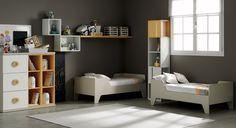 Habitación infantil doble con acabado en colores neutros como el gris