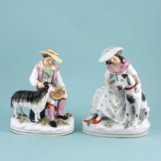 Pair of Staffordshire Shepherd & Shepherdess figures