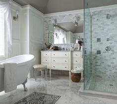 Master bathroom, warm gray ceiling paint, panel detail, claw foot tub, marble ...