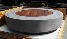 concrete fire pit with decking lid. use it as a table for drinks and food when it is not in use