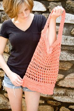 This bag is 30% off! Originally $30.    Super cute and airy beach bag/market tote, created by combining knit and crochet stitches for a completely one-of-a-kind pattern. Created with 100% cotton yarn, this bag is extremely durable and sturdy. Will hold all of your beach necessities or market finds, and is perfect for any adventure! Machine wash and dry.