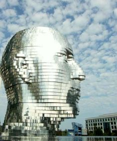 """""""Metalmorphosis"""" by Czech artist David Cerny - a 30' tall stainless steel sculpture divided into horizontal slices that slowly rotate out of sync with one another (video link) Charlotte, North Carolina"""