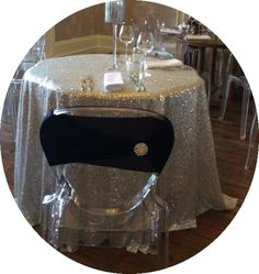 Silver sequin cloth with a ghost chair with added navy