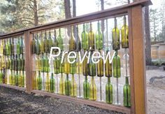 Mel and Mike Steinbach''s wine-bottle fence was made by drilling a hole in the bottom of each bottle and running a piece of rebar through it. -