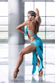 Yikes! Her back arm! Nice pose, though. Pretty aqua dress. #latindance #dance #dancesport