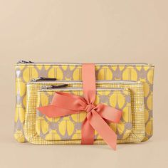 I love ALL the grey and yellow ladybug bags and accessories by Fossil!