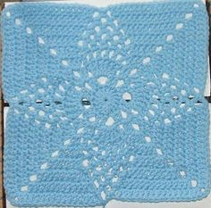"""Pineapple Blossom  Finished size: 12 inches square  MATERIALS: Approx. 4 ounces worsted weight yarn (light blue used for example), US size """"..."""