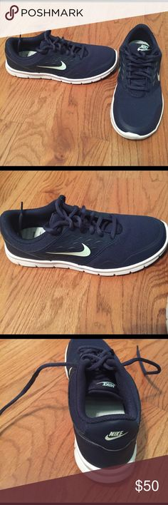 Brand New navy Nike sneakers Worn once in store, brand new Nike navy sneakers with light blue check on side Nike Shoes Athletic Shoes