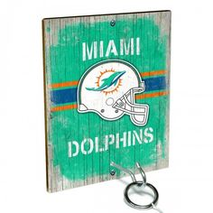 Team Toss for Miami Dolphins fans from Team ProMark is a fun and addictive game that's easy to learn but difficult to master. Toss the ring on the eye hook and score a point. The vintage team board designs make a great addition to any fan cave or game room wall. Play individually or pair up for teams while the gang is over watching the game.
