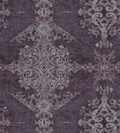 Arco Wallcovering A stunning non-woven wallcovering with great movement and texture. Featuring an ornate gothic design displayed in columns, printed in shades of purple with metallic silver highlights.