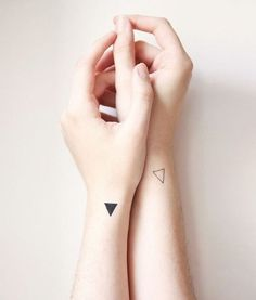 Hipster triangle tattoos on side of wrists. Filled in and outline.. couple-y. #rasspink http://www.superrassspy.com/