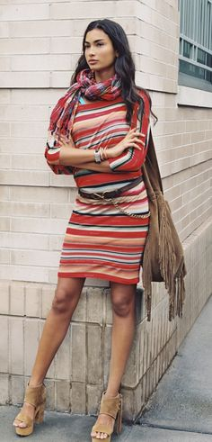 Polo Ralph Lauren Spring Dresses: Designed with a versatile neckline that can be worn on or off the shoulders, this jacquard-knit dress features three-quarter-length sleeves and a serape-inspired striped pattern.