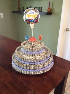Money Cake.   Great gift idea for a Graduate, Retiree, or Birthday.  My friend Amy made this for her son for his birthday.  I love it!