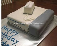 Homemade Wii Cake: I carved a double layer sheet cake for the console of the Wii cake.  The remote is a carved loaf pan size cake.    All covered in marshmallow fondant.