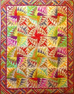 """""""The Carousel"""" Russian patchwork quilt.  We recognize the pattern as """"Untitled"""" by Karen K. Stone"""