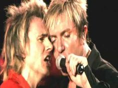 """In this edition of Fashion FM, """"The Wild Boys"""" shine on new wave radio stations. Who are the self-proclaimed """"Wild Boys? Duran D. London 2005, Angelo Kelly, Maite Kelly, Paddy Kelly, Nick Rhodes, Barbara Ann, Uk Singles Chart, Book Of The Dead, Simon Le Bon"""