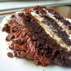 Chocolate layer cake with cream cheese filling and chocolate buttercream--can you imagine? Cream cheese filling AND chocolate buttercream? I can't take my eyes off of this slice of decadence!!..