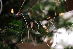 Joy to the World Tree by wildolive, via Flickr.  Love this version of the wire word ornament!