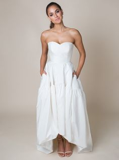 "'Katrina Arnold' Fashion-forward and unique, this high-low wedding dress features a ruched sweetheart neckline, a natural waist, a gathered skirt with pockets, and a chapel train. See this gown and other bridal separates from the Build-A-Bride by heidi elnora line on ""Bride by Design"" on TLC!"