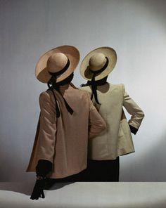 Two models seen from behind are wearing Traina-Norell box-coats and straw shantung ribboned hats.    Image by © Condé Nast Archive/Corbis  | dovima_is_devine_II, via Flickr