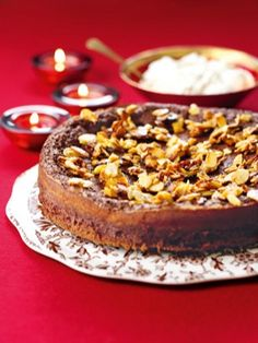 CHRISTMAS-SPICED CHOCOLATE CAKE There are few more popular ways to end a dinner party than with a fallen chocolate cake – the cakes are so called because they are compact and flourless and, when cooling out of the oven, their rich centres drop and dip a little.