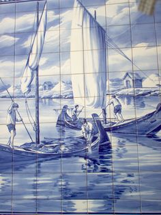 Hand painted azulejo panel (#Portuguese tiles) Moliceiros and harvesting seaweed; salt pans and wooden huts beyond. Aveiro
