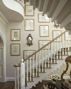 White foyer with gallery walls