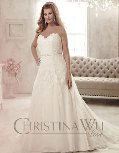 A gorgeous lace and tulle a-line gown adorned with beads and a thin satin belt to draw your waistline in.