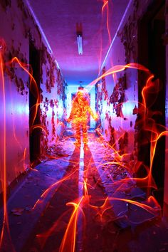 Photographer Dennis Calvert does not use digital manipulation for any of his pictures. With the right exposure on his camera, he swings around glow sticks in a dark room or outdoors at night to create his desired visual effect.