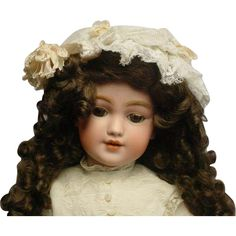 Terrific Santa doll 1248. She is a 18 Bisque composition jointed Doll made by Simon and Halbig: 1248 Germany Simon  Halbig SH 8. This beautiful doll