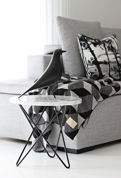 monotone black and white marble table & Eames bird - living room