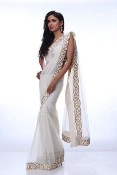 A stunning creme net saree embossed with gold and silver border adds elegance to this ensemble. How To Get A Custom Wedding Dress Made Saris, Indian Dresses, Indian Outfits, Indian Clothes, Beautiful Saree, Beautiful Dresses, Satya Paul Sarees, Indische Sarees, Indie Mode