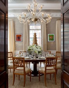 Oh the millwork in this dining room is absolutely gorgeous! Elegant choice of furniture: round table and chandelier.. Lovely Cullman & Kravis: Show Houses